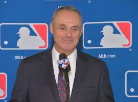 MLB Commissioner Rob Manfred said in an interview Wednesday that he is opening to revisit the topic of gambling and believes sports betting should be regulated.