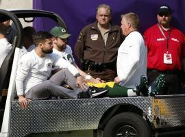 Green Bay quarterback Aaron Rodgers is seen on a cart being driven off the field after breaking his collarbone against Minnesota October 15. (Image: Associated Press)