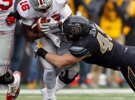 Ohio State's J.T. Barrett had a rough game against Iowa last weekend throwing for four interceptions in the 55-24 loss. (Image: AP)