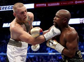 Predictably, bookmakers have made Conor McGregor a heavy favorite over Floyd Mayweather in a hypothetical MMA fight between the two. (Image: Getty)