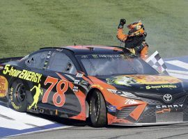 Martin Truex Jr. won the Auto Club 400 by 11 seconds to capture his first NASCAR Cup Series victory of the 2018 season. (Image: AP/Will Lester)