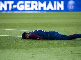 Soccer star Neymar lies on the field in pain after breaking a bone in his foot in a match with his regular team, Paris Saint-Germain. (Image: AFP)