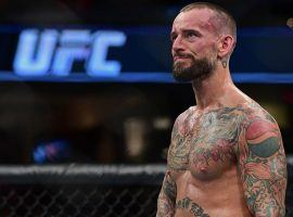 CM Punk, seen here after his 2016 loss to Mickey Gall, will return to the octagon for a fight with Mike Jackson at UFC 225. (Image: David Dermer/AP)