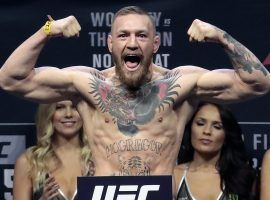 Conor McGregor faces charges of assault and criminal mischief following an attack on a bus carrying other fighters at the UFC 223 media day. (Image: Julio Cortez/AP)