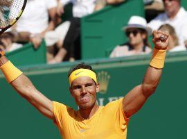 Rafael Nadal celebrates his 11th career Monte Carlo Masters title after defeating Ken Nishikori 6-3, 6-2 on Sunday. (Image: Chistope Ena/AP)