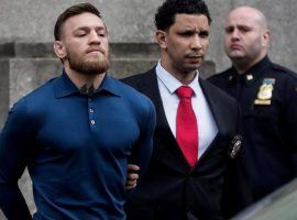 Conor McGregor is led out of jail in handcuffs after his arrest last week in New York City. (Image: Reuters)