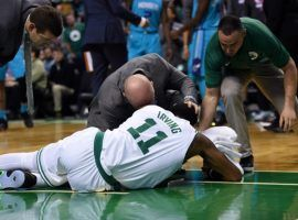 Boston Celtics star guard Kyrie Irving has suffered a setback after an operation discovered a bacterial infection in his surgically repaired left knee and the 26 year old will miss the rest of the regular season and playoffs. (Image: USA Today Sports)