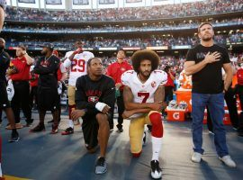 Eric Reid (left) and Colin Kaepernick kneel during the national anthem before a game on September 1, 2016. (Image: Michael Zagaris/Getty)