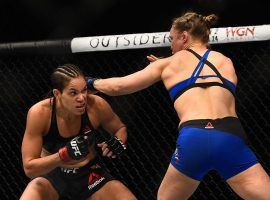 Amanda Nunes dodges a punch from Ronda Rousey during their championship fight on December 30, 2016. Nunes will defend her bantamweight title this weekend at UFC 224.  (Image: Jeff Bottari/Zuffa LLC/Getty)