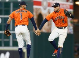 Carlos Correa and George Springer celebrate during the Houston Astros' 7-4 win over the Kansas City Royals on Sunday, the team's 11th consecutive victory. (Image: Bob Levey/Getty)