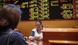 A gambler collects a winning bet from the sportsbook at the South Point Hotel Casino in Las Vegas. (Image: AP/John Locher)
