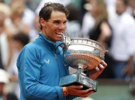 Rafael Nadal poses with the trophy after beating Dominic Thiem in straight sets to win his 11th career French Open title. (Image: Thibault Camus/AP)