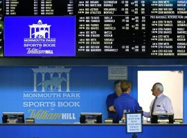 Employees prepare to take bets on opening day of the Monmouth Park Sports Book in Oceanport, New Jersey. (Image: AP/Noah K. Murray)