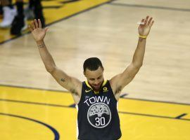Stephen Curry celebrates during Game 2 of the 2018 NBA Finals. Curry made nine 3-pointers in the game, setting an NBA Finals record. (Image: AP/Ben Margot)