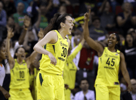 Breanna Stewart (30) celebrates during a 101-83 victory by the Seattle Storm over the Connecticut Sun during the 2018 WNBA regular season. (Image: Elaine Thompson/AP)