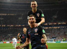 Mario Mandzukic (17) celebrates after scoring the winning goal in Croatia's 2-1 extra time victory over England in the semifinals of the 2018 FIFA World Cup. (Image: Getty)