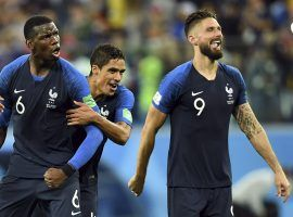 Paul Pogba (6), Olivier Giroud (9), and Raphael Varane (4) celebrate following France's 1-0 win over Belgium in the semifinals of the 2018 FIFA World Cup. (Image: Tim Groothuis/USA Today Sports)