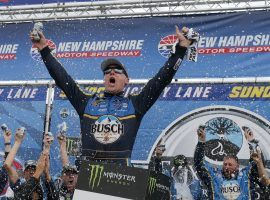 Kevin Harvick celebrates after winning the Foxwoods Resort Casino 301 at New Hampshire Motor Speedway on Sunday. (Image: Mary Schwalm/AP)