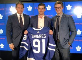 John Tavares shows off his new jersey after signing a seven-year contract with the Toronto Maple Leafs. (Image: Toronto Maple Leafs)