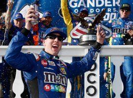 Kyle Busch celebrates after winning the Gander Outdoors 400 at Pocono Raceway on Sunday. (Image: Jeff Zelevansky/Getty)