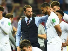 England Manager, Gareth Southgate, consoles his team after their bitter loss to Croatia. (Image: AFP)