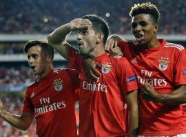 Benfica's Pizzi (center) celebrates with teammates after scoring on a penalty kick in his team's 1-1 draw against PAOK during the first leg of the Champions League playoffs. (Image: AP/Armando Franca)