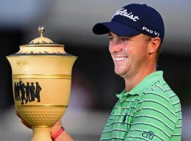 Justin Thomas holds the Gary Player Cup after his victory at the WGC-Bridgestone Invitational on Sunday. (Image: David Dermer/AP)