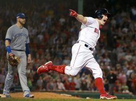 Brock Holt celebrates after hitting a home run in the seventh inning of the Boston Red Sox 7-2 victory over the Toronto Blue Jays on Tuesday. (Image: Jim Davis/Boston Globe)