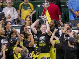 MVP Breanna Stewart lifts the trophy and celebrates with her teammates after the Seattle Storm swept the Washington Mystics to win the WNBA Finals. (Image: Bettina Hansen/Seattle Times)