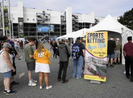 Bettors line up to wager on Sunday's NASCAR Cup Series race at Dover International Speedway. (Image: Nick Wass/AP)