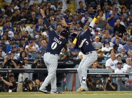 Brewers infielder Orlando Arcia (3) celebrates with third base coach Ed Sedar (0) during Milwaukee's 4-0 win over the Los Angeles Dodgers in Game 3 of the 2018 NLCS. (Image: Getty)