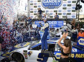 Chase Elliott pulled away in an overtime session to win at Dover International Speedway on Sunday, and secure his advancement to the next round of NASCAR's playoffs. (Image: AP)