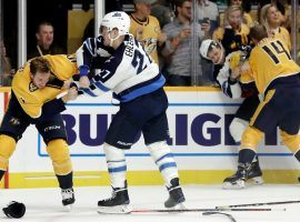 Nashville's Colton Sissons (left) and Winnipeg's Nikolaj Ehlers (right) tussle in a line fight during an intense division game (Image: AP)
