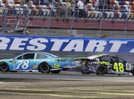 Jimmy Johnson (48) attempted to pass Martin Truex Jr. (78) on the final turn at Charlotte Motor Speedway, resulting in a crash that eliminated Johnson from the NASCAR playoffs. (Image: Chuck Burton/AP)