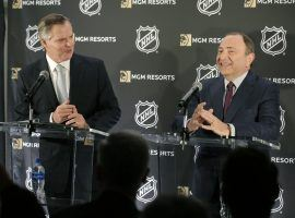 MGM Resorts International CEO James Murren (left) and NHL commissioner Gary Bettman (right) announce their new sports betting partnership at a press conference on Monday. (Image: Seth Wenig/AP)