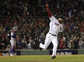 Eduardo Nunez celebrates after hitting a three-run home run for the Boston Red Sox against the Los Angeles Dodgers in Game 1 of the 2018 World Series. (Image: David J. Phillip/AP)
