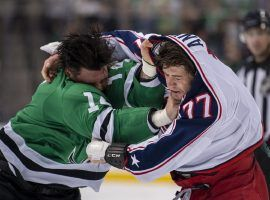 Jamie Benn (14) and Josh Anderson (77) tussle in the first period of the Dallas Stars and Columbus Blue Jackets game. (Image: Jerome Miron/USA Today)