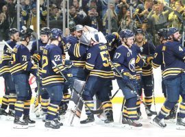 The Buffalo Sabres celebrate after winning their 10th consecutive game on Tuesday night. (Image: James McCoy/Buffalo News)