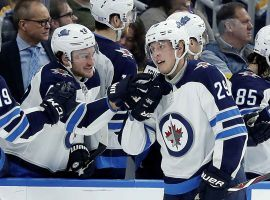 Winnipeg Jets' Patrik Laine (29), of Finland, is congratulated by Brendan Lemieux after scoring during the second period against the St. Louis Blues. (AP Photo/Jeff Roberson)