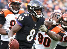 Rookie QB Lamar Jackson from the Baltimore Bengals stiff arms Michael Johnson (90) from the Cincinnati Bengals. (Image: Mitch Stringer/USA Today)