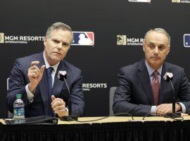 MGM Resorts CEO Jim Murren (left) and MLB commissioner Rob Manfred (right) announced a gaming partnership on Monday, the third for the casino firm. (Image: AP/ Seth Wenig)