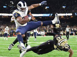 Rams RB Malcolm Brown leaps for a touchdown in the Superdome. (Image: Wally Skalij/LA Times)