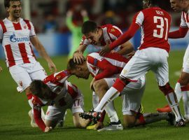 Red Star Belgrade players celebrate after the first goal of their 2-0 victory over Liverpool in Champions League play. (Image: AP/Darko Vojinovic)