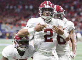 Quarterback Jalen Hurts celebrates after scoring against Georgia in the SEC Championship Game on Saturday. (Image: AJ Reynolds/Athens Banner-Herald/AP)