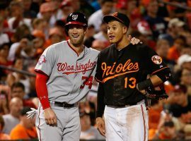 Bryce Harper (left) and SS Manny Machado (right) are highly-coveted free agents this season. (Image: Rob Carr/Getty)