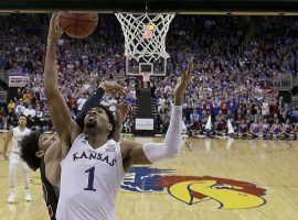 Dedric Lawson (1) of Kansas goes in for a layup against New Mexico State's C.J. Bobbitt during a game between the two teams on Dec. 8. (Image: Charlie Riedel/AP).