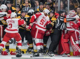 The Detroit Red Wings and Boston Bruins involved in fisticuffs during a highly-physical game in Boston. (Image: Adam Richins/BSJ)