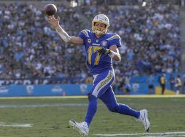 Quarterback Philip Rivers, from the LA Chargers, rolling out in a game against the Arizona Cardinals in Carson, CA. (Image: Robert Gauthier/LA Times)