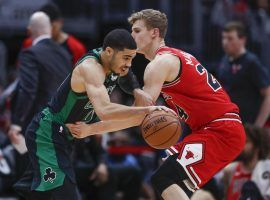The Celtics' Jayson Tatum drives by Lauri Markkanen from the Bulls during a laugher in Chicago. (Image: Kamil Krzaczynski/AP)
