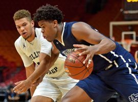 Vernon Carey Jr, from University Prep, drives by a Gulliver Prep player during the Hoophall Miami Showcase in Miami last year. (Image: Jasen Vinlove/USA Today)